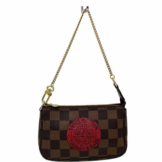Preload https://img-static.tradesy.com/item/24808316/louis-vuitton-pochette-accessoires-pochette-trunks-and-damier-ebene-mini-shoulder-bag-0-0-540-540.jpg