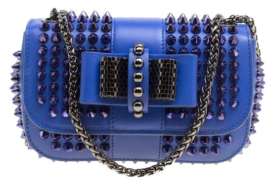 Preload https://img-static.tradesy.com/item/24811453/christian-louboutin-spiked-sweet-charity-blue-leather-and-fabric-cross-body-bag-0-1-540-540.jpg