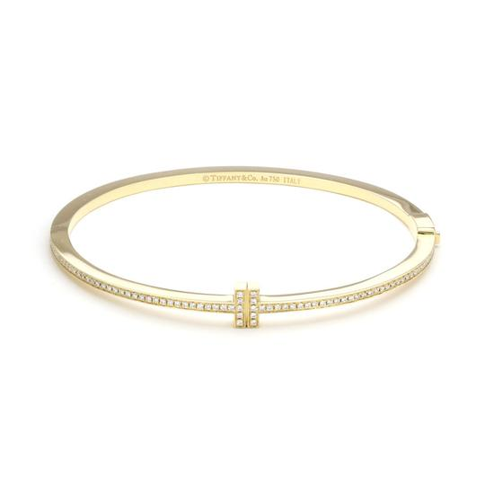 Preload https://img-static.tradesy.com/item/24811687/tiffany-and-co-22730-t-two-diamond-18k-yellow-gold-hinged-bangle-bracelet-0-0-540-540.jpg