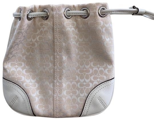 Preload https://img-static.tradesy.com/item/24812770/coach-monogram-pull-string-wristlet-ivory-canvas-and-leather-hobo-bag-0-1-540-540.jpg