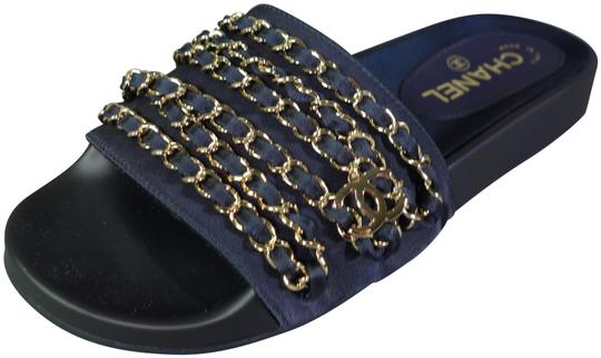 Preload https://img-static.tradesy.com/item/24813183/chanel-dark-navy-blue-gold-woven-chains-dangle-cc-charm-mules-slides-sandals-new-flats-size-eu-37-ap-0-1-540-540.jpg