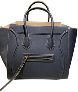 Céline Satchel in navy with tan piping