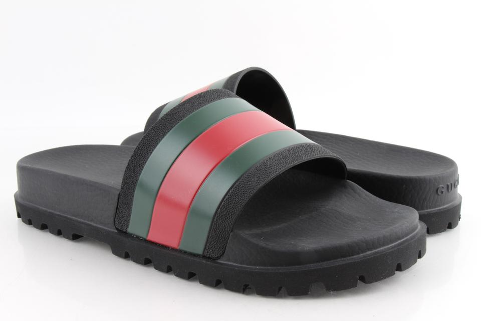 1f059738099 Gucci Black Pursuit 72 Rubber Slide Sandals Shoes Image 0 ...