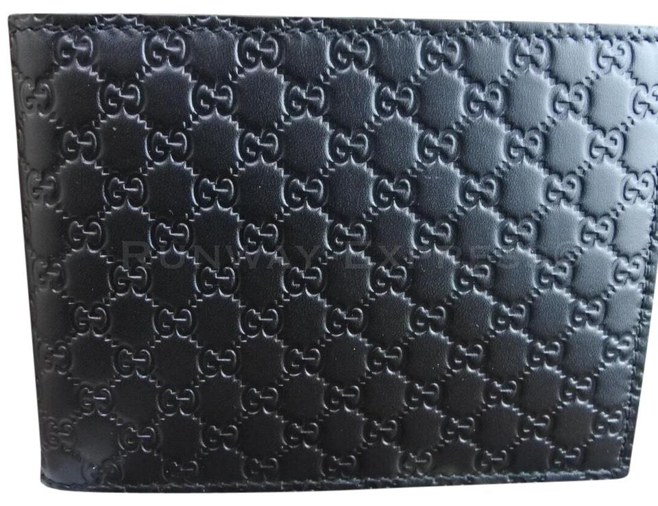 805c1fd54856 Gucci Gucci Black Guccissima Leather Men's Wallet Image 0 ...