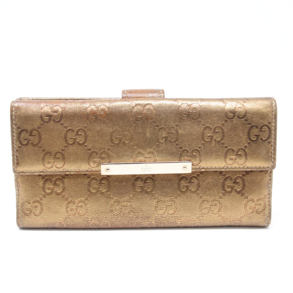 09496b1d042924 Gucci Metallic GG Embossed Guccissima Leather Long Flap Wallet Image 0 ...