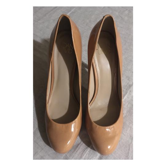 Preload https://img-static.tradesy.com/item/24834316/joan-and-david-nude-patent-leather-pumps-size-us-55-regular-m-b-0-1-540-540.jpg