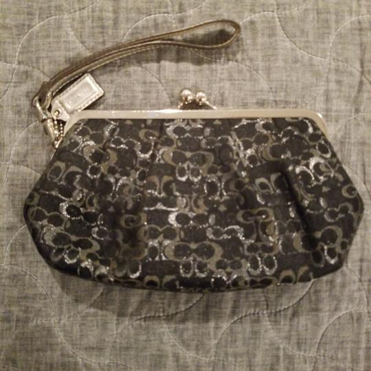 Preload https://img-static.tradesy.com/item/24834343/coach-and-silver-shimmer-clutch-0-0-540-540.jpg