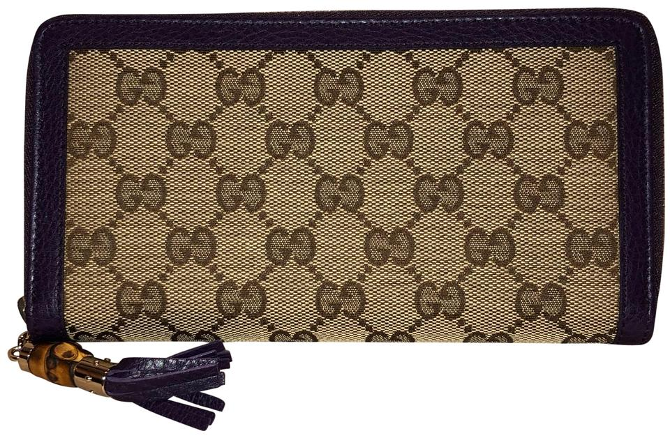 ce4ee4f823bb Gucci Guccissima Canvas Purple Brown Leather Bamboo Tassel Zip Around Wallet  Image 0 ...
