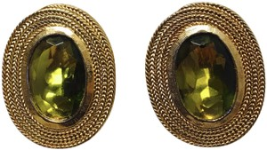 Vintage Clip Earring with a gold trim and green olive stone