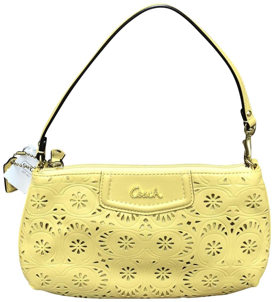 637e5c0c4c0a Coach Perforated Leather Signature Logo Wristlet in Yellow Image 0 ...