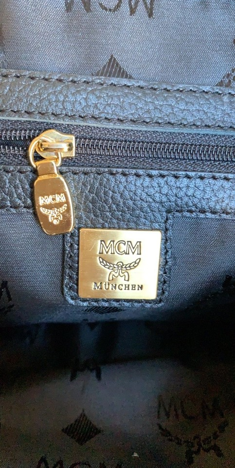 0451d028425bac MCM Vintage W/ Golden Studded Logo Motifs Small Black Leather Backpack -  Tradesy