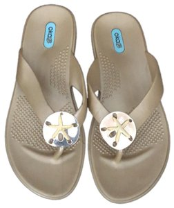OKA b. Tan with gold and silver. Sandals