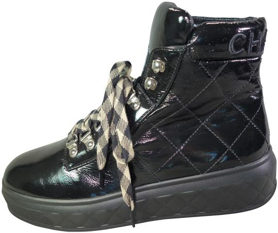 Preload https://img-static.tradesy.com/item/24859686/chanel-black-lace-up-cc-quilted-smooth-patent-moto-biker-ankle-new-bootsbooties-size-eu-39-approx-us-0-1-540-540.jpg