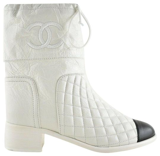 Preload https://img-static.tradesy.com/item/24860272/chanel-white-drawstring-18b-black-quilted-crumpled-calfskin-leather-cc-short-bootsbooties-size-eu-35-0-1-540-540.jpg