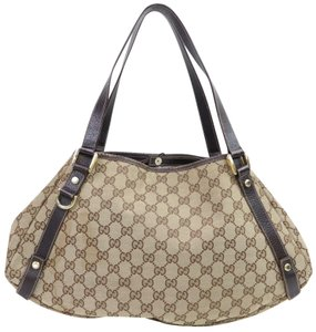c7c94bea1eaf Gucci Abbey Monogram Gg Hobo 870102 Brown Canvas Shoulder Bag - Tradesy