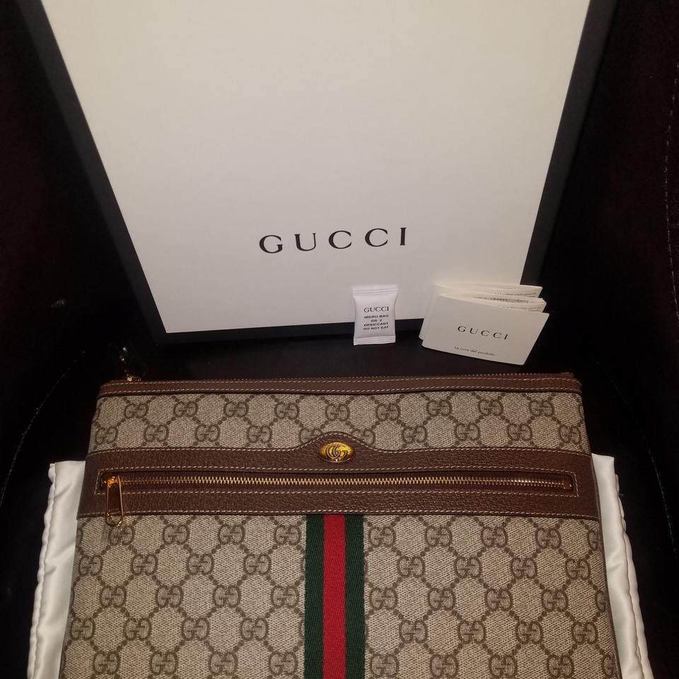 3b7380589763 Gucci Beige/ebony canvas color with brown leather trim Clutch Image 0 ...