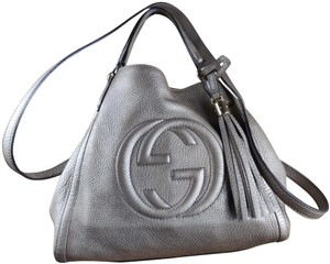 7fe2bca45566 Added to Shopping Bag. Gucci Tote in metallic light gold. Gucci Soho Small  Convertible ...