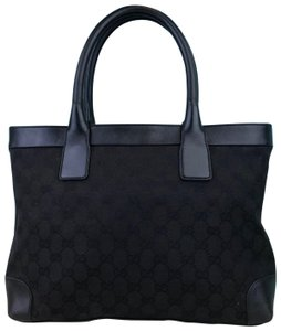 6da2f30b14ff Added to Shopping Bag. Gucci Monogram Canvas Tote in Black. Gucci Monogram  Gg Web Leather ...