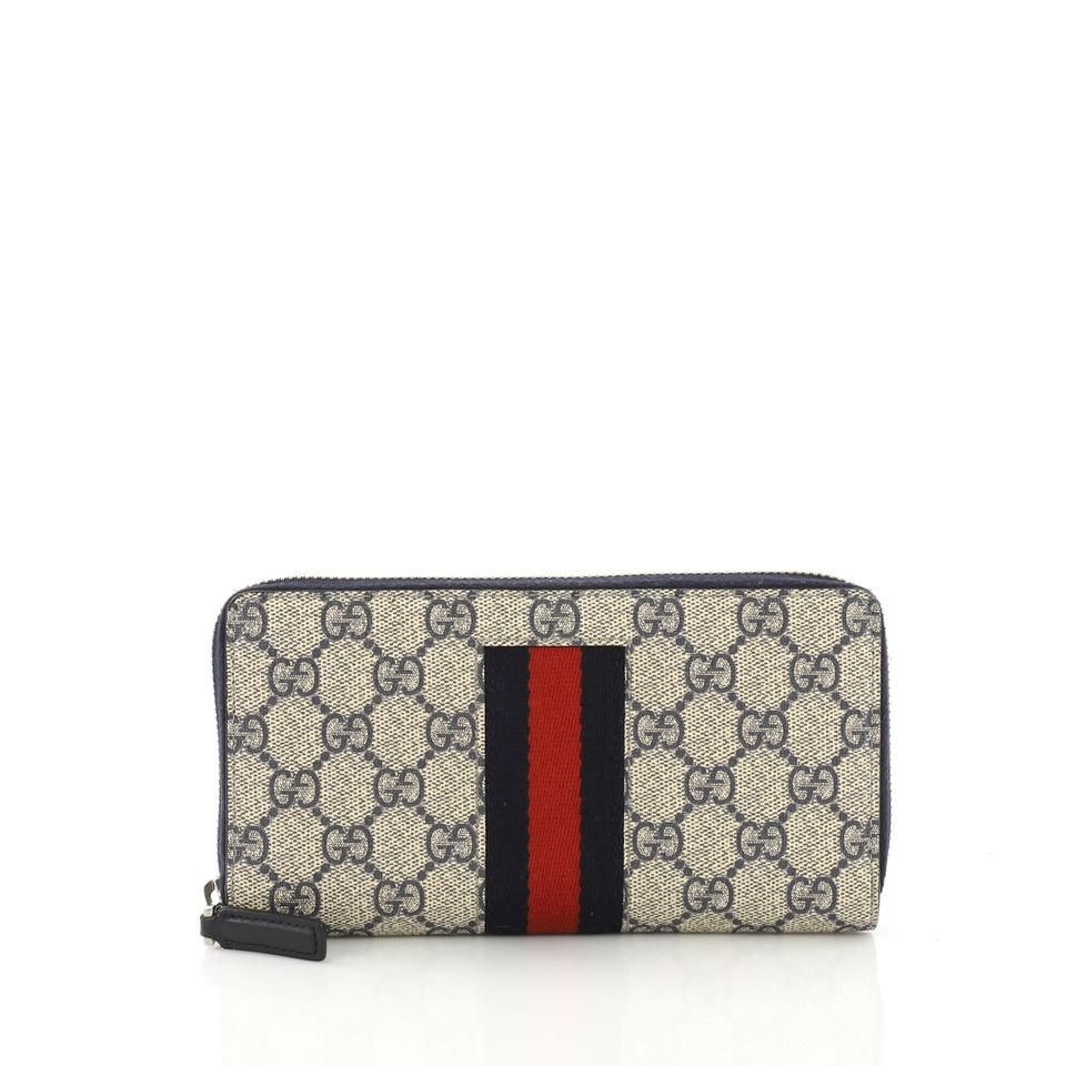 878d62ac5cc545 Gucci Blue Web Zip Around Gg Coated Canvas Wallet - Tradesy