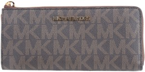 f1085d32576e Michael Kors Michael Kors Jet Set Travel Large Three Quater Zip Around  Wallet