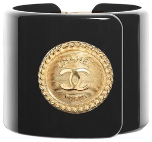 Chanel resin cuff Soldout cream and Black w antique gold.