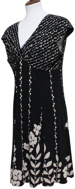 Preload https://img-static.tradesy.com/item/24899002/jones-new-york-black-and-white-floral-mid-length-casual-maxi-dress-size-petite-12-l-0-1-650-650.jpg