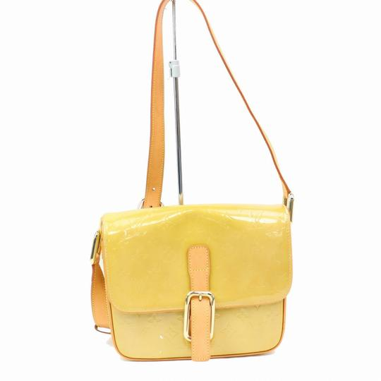 Preload https://img-static.tradesy.com/item/24899053/louis-vuitton-christie-monogram-vernis-gm-cross-body-870192-yellow-beige-canvas-shoulder-bag-0-0-540-540.jpg