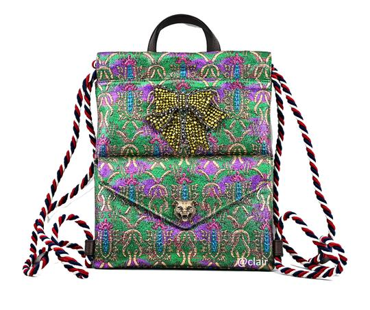 Preload https://img-static.tradesy.com/item/24899118/gucci-animalier-and-chrystal-bow-drawstring-multicolor-brocadeleather-backpack-0-1-540-540.jpg