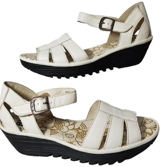 Preload https://img-static.tradesy.com/item/24899729/fly-london-off-white-leather-wedge-sandals-size-eu-41-approx-us-11-regular-m-b-0-1-540-540.jpg