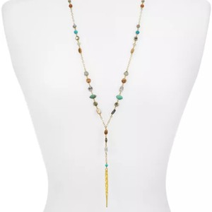 Chan Luu Metallic necklace features Green stone with dagger pendant