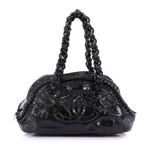 1a1c5995fac9 Added to Shopping Bag. Chanel Leather Medium Satchel in black. Chanel Resin Luxe  Ligne Bowler ...