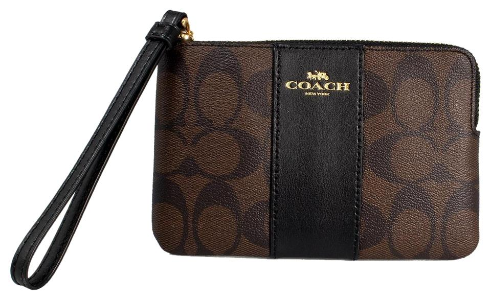 0576bb31dde11 Coach Brown Black Corner Zip Wristlet In Signature Coated Canvas with  Leather Stripe Wallet