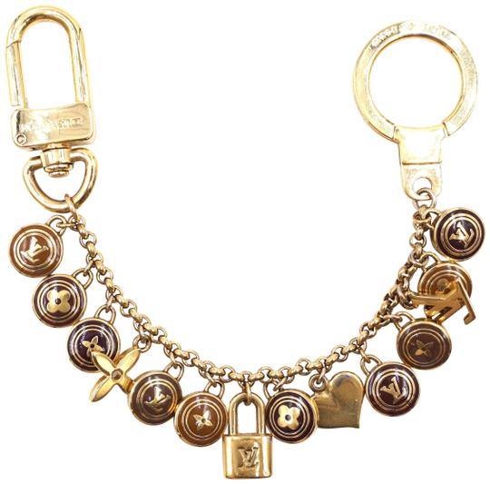 Preload https://img-static.tradesy.com/item/24903157/louis-vuitton-27605-gold-and-brown-ultra-rare-monogram-lock-key-ring-chain-for-bag-charm-0-2-540-540.jpg