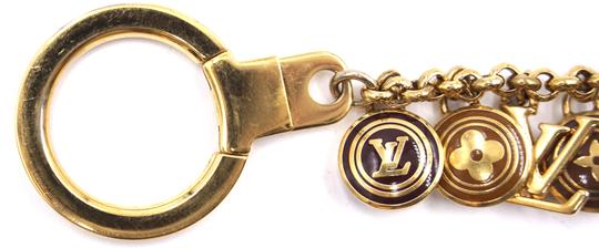 Louis Vuitton Ultra RARE monogram gold lock charms key ring chain for bag