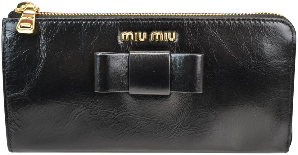 c4f11540f36b Miu Miu Black Distressed Leather Bow Zip Logo Continental Wallet ...