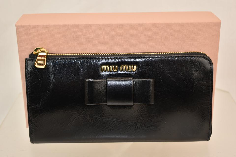 881577caa597 Miu Miu BLACK DISTRESSED LEATHER BOW ZIP LOGO CONTINENTAL WALLET Image 11.  123456789101112