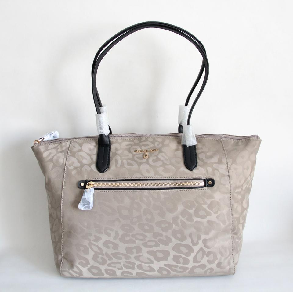 76491627d378d Michael Kors Kelsey Large Top Zip Leopard Print Travel Beige Nylon Tote