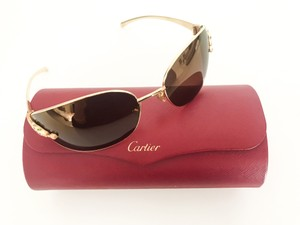 Cartier Limited Edition Cartier Panther frame with green eye stones goldframe