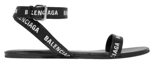 Preload https://img-static.tradesy.com/item/24912686/balenciaga-logo-printed-leather-sandals-size-us-9-regular-m-b-0-1-540-540.jpg