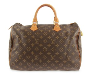 0459507ed803 Added to Shopping Bag. Louis Vuitton Speedy Vintage Satchel in Brown. Louis  Vuitton Speedy 35 Monogram Brown Coated Canvas Satchel