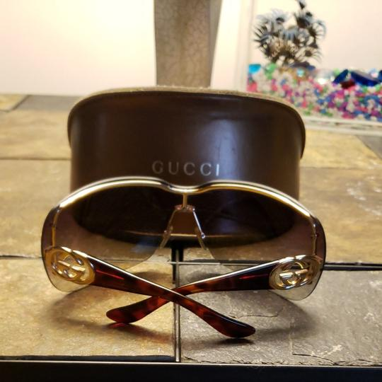 Gucci Gucci sunglasses tortishell frames with gold GG on the earpiece temples and dark brown Ombre polarized lenses. Comes with case. Minor scratches not noticable from minimal use. Image 1