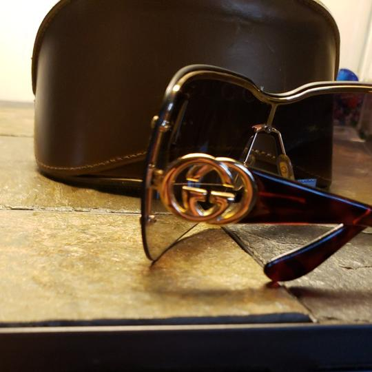 Gucci Gucci sunglasses tortishell frames with gold GG on the earpiece temples and dark brown Ombre polarized lenses. Comes with case. Minor scratches not noticable from minimal use. Image 2