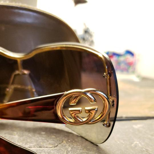 Gucci Gucci sunglasses tortishell frames with gold GG on the earpiece temples and dark brown Ombre polarized lenses. Comes with case. Minor scratches not noticable from minimal use. Image 3