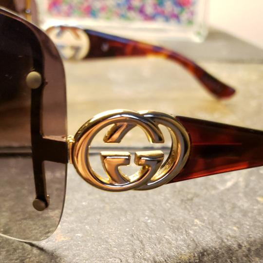 Gucci Gucci sunglasses tortishell frames with gold GG on the earpiece temples and dark brown Ombre polarized lenses. Comes with case. Minor scratches not noticable from minimal use. Image 5