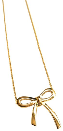 Preload https://img-static.tradesy.com/item/24919549/tiffany-and-co-very-rare-very-18k-yellow-gold-with-bow-pendant-necklace-0-6-540-540.jpg