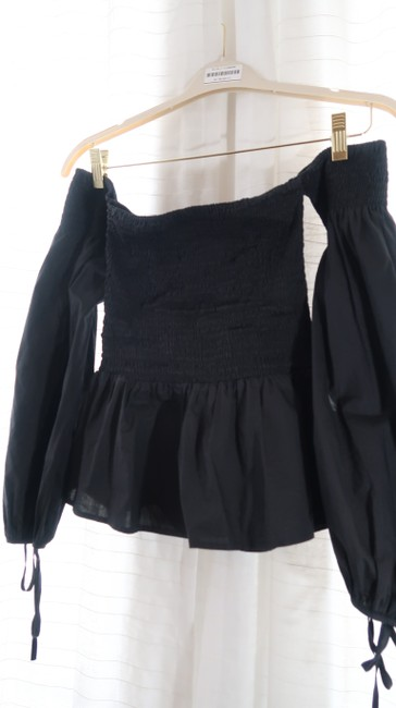 VETIVER Off-shoulder Crop Smocked Peplum Top black Image 1