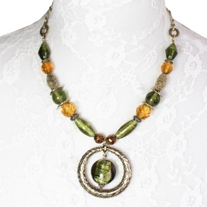 Lia Sophia Green and Brass Tone Pendant Necklace