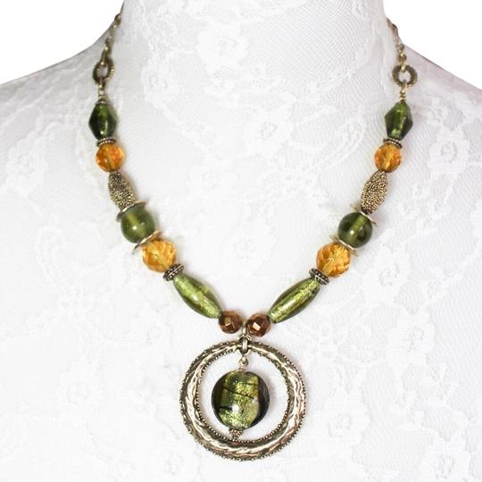 Preload https://img-static.tradesy.com/item/24919864/lia-sophia-green-and-brass-tone-pendant-necklace-0-1-540-540.jpg