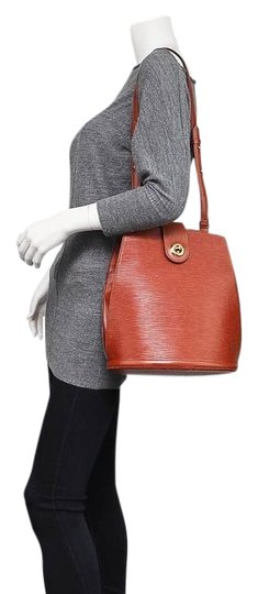 Preload https://img-static.tradesy.com/item/24929321/louis-vuitton-cluny-sp0937-brown-epi-leather-tote-0-1-540-540.jpg