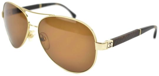 Preload https://img-static.tradesy.com/item/24935098/chanel-aviator-gold-metal-cc-logo-and-leather-polarized-yr-sunglasses-0-1-540-540.jpg